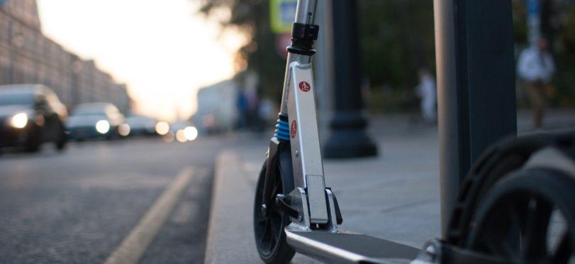scooter parked brand hidden - Unsplash