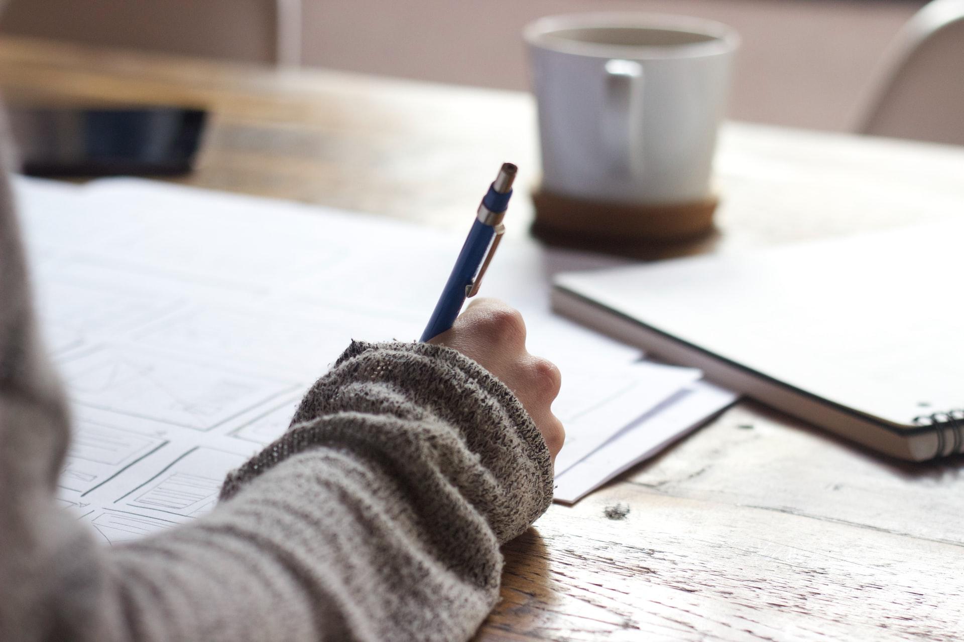 Studying, writing - Unsplash